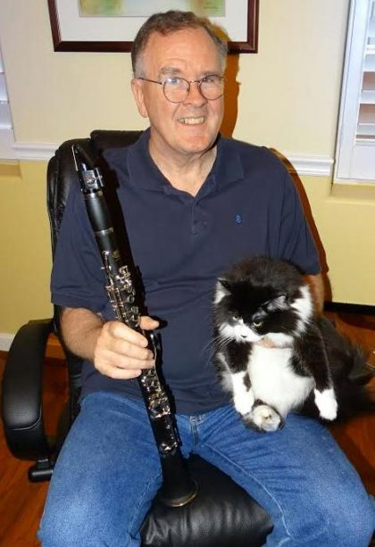 Emersonian Ben Withers with his clarinet and cat